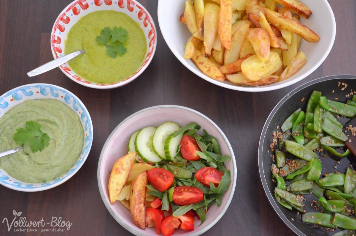 Bowl mit Koriander-Dips, Zuckerschoten und Kartoffelspalten